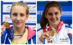 female Para swimmers Louise Fiddes and Monica Boggioni holding up gold medals and smiling