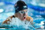 female Para swimmer Rebecca Meyers takes a breath mid-breaststroke