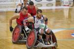 male wheelchair rugby player Josh Wheeler of USA sprints away with the ball