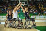 Female wheelchair basketball player Mariska Beijer fighting with another player for the ball