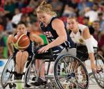 female wheelchair basketball player Rose Hollermann rolls with the ball