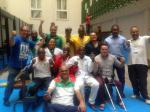 a group of African powerlifting officials smile for the camera