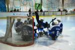 Finland's Para ice hockey team huddle in front of their goal