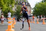 female Para triathlete Liisa Litja running round a corner on the road