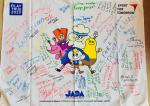a flag from the Raise the Bar anti-doping programme covered with signatures