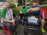 male Para shooter Phil Eaglesham with his coach and assistant outside