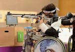 Man in a wheelchair shooting a rifle