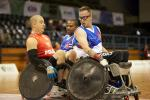 French and Polish wheelchair rugby players in action on the court