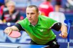 male Para table tennis player Viktor Didukh plays a forehand