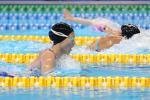 female Para swimmer Amilova Fotimakhon takes a breath during a breaststroke
