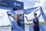 female Para triathlete Amy Dixon and her guide cross the finish line