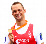 Cutout of Dutch male rower smiling while holding his medal