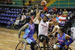 male wheelchair basketballers from Mexico and Puerto Rico fight for the ball