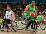 male wheelchair basketballer Leandro de Miranda shields the ball from another player