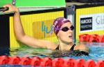 female Para swimmer Ellie Cole holding on to the pool edge