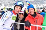 male Para alpine skier Arthur Bauchet smiles with his parents, one of whom is wearing a blue chicken on his head