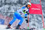 female Para alpine skier Ilma Kazazic skies round a gate