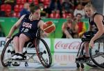 female wheelchair basketballer Rebecca Murray dribbles the ball on court