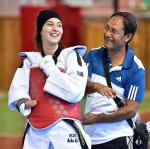 female Para taekwondo fighter Meryem Betul Cavdar smiles with her coach