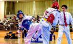 male Para taekwondo fighter Kenta Awatari kicks another fighter