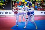 female Para taekwondo fighter Rajae Akermach kicks her opponent in the upper body