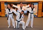 a group of Turkish taekwondo fighters posing for the camera