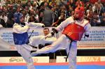 male Para taekwondo fighter Matt Bush kicks another fighter around the legs