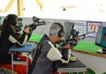 A female and a male vision impaired shooters competing