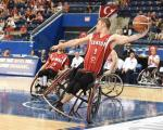male wheelchair basketballer Liam Hickey tilts sideways as he prepares to throw the ball