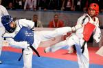 male Para taekwondo fighter Rachid Ismaili Alaoui kicks another fighter in the chest