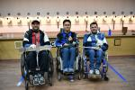 Three male shooters in wheelchairs