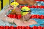 male Para swimmer Timothy Disken punches the water with happiness after winning a race
