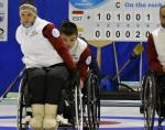 female wheelchair curler Polina Rozkova plays a stone