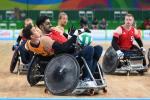 wheelchair rugby players grappling for the ball