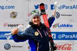 female Para alpine skier Marie Bochet holds up two crystal globe trophies