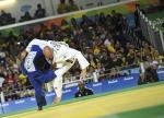 male Para judoka Sam Ingram throws another judoka onto the mat