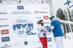 female Para snowboader Cecile Hernandez accepts her gold medal on the podium