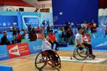 male and female Chinese Para badminton players in wheelchairs playing on the court