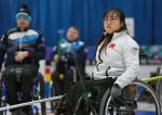 female wheelchair curler Zhou Yan on the ice