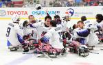 A group of USA Para ice hockey players celebrating