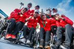 Japanese quad team smile and show their gold medal to the camera