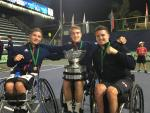 British players smile at the camera while showcasing the trophy