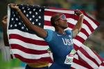 male vision impaired sprinter David Brown holding up the USA flag
