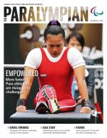 Magazine cover photo of Asian powerlifting bowing her head