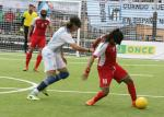 Behzad Zadaliasghari dribbles past Argentinian defender Froilan Padilla