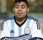 Argentinian blind football player Maximiliano Espinillo poses for the photo