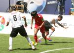 Chinese blind football player Wei Jiansen dribbles past one Moroccan defender and prepares to shoot
