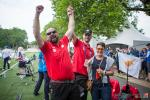 Vision impaired male archer celebrates with his coach hugging him