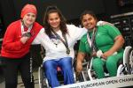 three female powerlifters on the podium