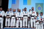 A group of vision impaired female and male judokas on the podium
